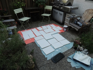 Even my own backyard became an artful space! Priming the wood.